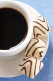 Chocolates y café blancos Foto de archivo libre de regalías