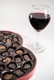 Chocolates y vino Imagen de archivo libre de regalías