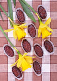 Chocolates with yellow daffodils Stock Photo