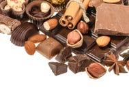 Chocolats délicieux d'isolement sur le fond blanc Photos libres de droits