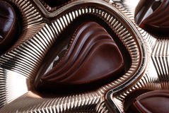 Chocolats dans le cadre de clinquant Image stock