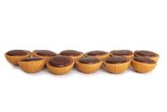 Chocolats de caramel sur le fond blanc Image libre de droits