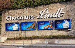 Chocolats Lindt advertisement in Zurich, Switzerland. Zurich, Switzerland - 27 January, 2017: advertisement of Chocolats Lindt on a stone wall at Central square Royalty Free Stock Photo