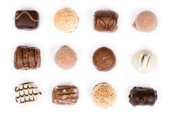 Chocolats sur le blanc Photographie stock libre de droits