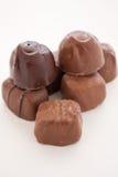 Chocolats sur le fond blanc Photographie stock libre de droits