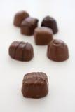 Chocolats sur le fond blanc Images libres de droits