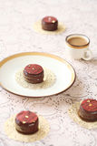 Chocorons - Macarons glazed in chocolate Royalty Free Stock Image
