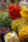 Chocs avec la diverse nourriture conservée Photographie stock libre de droits