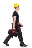 Chodzący repairman przewożenia toolbox Zdjęcia Stock