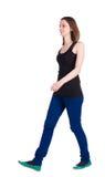 Chodząca kobieta tylny widok. Zdjęcie Royalty Free