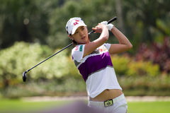 Choi finishes her swing at LPGA Malaysia. South Korean Na Yeon Choi looks on after her fairway shot to green on Day 1 of the Sime Darby LPGA Golf October 22 Royalty Free Stock Photo