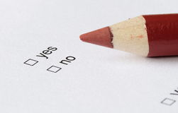 Choice. Yes or no checkboxes with red pencil Royalty Free Stock Photography