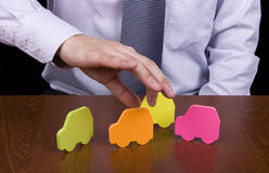 Choice. Hand of a business man picking the orange car Royalty Free Stock Image