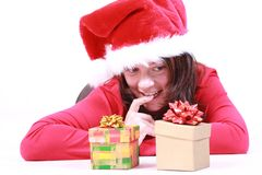 Choice. Beautiful young woman with gifts - Santa Claus isolated on white Stock Photo