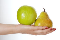 Choice. Apple and pear lying on hand. White background. Choice concept Stock Image