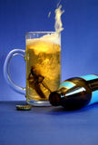 Choice. The choice is always there: Drink OR Drive.  Hopefully, the choice made will be the responsible one.   Car keys splashing into a glass mug of beer with Royalty Free Stock Photo