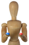 Choice. Wood mannequin choose blue or red pill Royalty Free Stock Photos