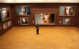 Choice. A man standing in front of women portraits collection Stock Image