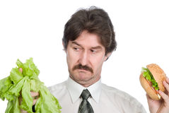 Choice of the businessman-salad or hamburger Royalty Free Stock Image