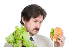Choice of the businessman-salad or hamburger Royalty Free Stock Photography