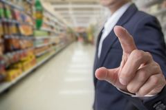Choice of buying for health concept : Businessman finger touching with supper market Royalty Free Stock Image