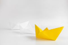 Choice concept paper boats on white background Stock Images