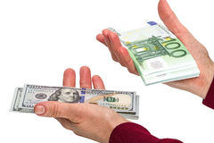 Choice - dollars or euros. Pack of 100 dollars and euro banknotes in the hands of women. Isolated on white background Royalty Free Stock Images