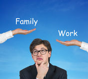 Choice of family or work Stock Photography