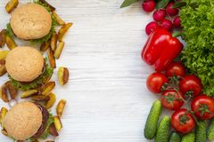 Choice between healthy food and fast food concept. Top view Royalty Free Stock Photo