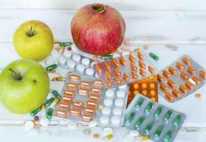 Choice Between Healthy Fruits or Pills royalty free stock photos