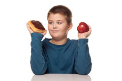Choice of a healthy or unhealth snack Stock Images