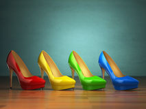 Choice of high heels shoes in different colors on vintage green Stock Image