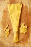 Choice of Italian pasta. Spaghetti penne farfalle Stock Photo