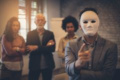The choice is just yours. Business people at the office. Person with mask on face. Focus on man stock photography