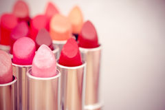 Choice of listicks/lipgloss colors. Cosmetics: lipsticks shot at shallow depth of field Royalty Free Stock Images