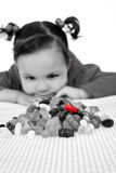 Choice - Little Girl. Image of a little girl who desperately wants the red jelly bean, conceptual choice / waiting. Great expression on the little girls face stock photography
