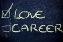Choice between love or career. Chalk writings on blackboard, choice between love or career Stock Photos