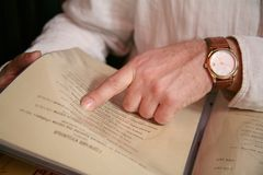 Choice in the menu. The man makes a choice of dishes from the menu Royalty Free Stock Images