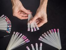 The choice of nail design. Shape nail tips fan. The choice of nail design. Shape nail tips fan royalty free stock images
