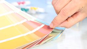 Choice from palette color scale, hand pointing stock footage