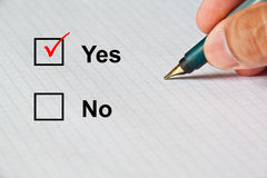 Choice on paper by classic pen. Select Yes in paper choices by classic pen stock photo