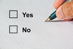 Choice on paper by classic pen. Yes and No paper choices by classic pen stock photos