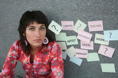 Choice of profession. Young woman trying to choose an occupation Royalty Free Stock Photos