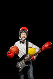 Choice of profession. The red-haired boy with a variety of implements on itself on a black background Stock Image