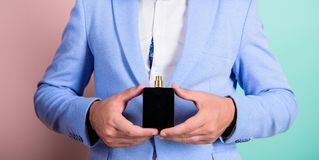 Choice of real man. Pick right fragrance. How choose best perfume according to occasion. Which is best fragrance for. Businessman. Male hands hold bottle stock image