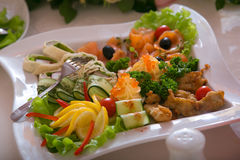 Choice of snacks. Dish with a choice of snack from seafood and vegetables Royalty Free Stock Photos