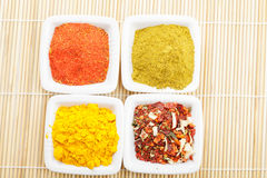 Choice of spices on mat above view Royalty Free Stock Photography