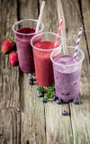 Choice of three delicious berry smoothies Royalty Free Stock Images