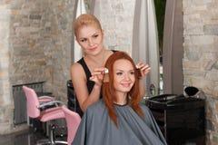 Choice of tone of hair in hair salon. Stock Photography