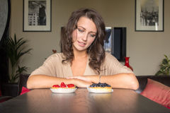 Choice between two cakes Stock Photography